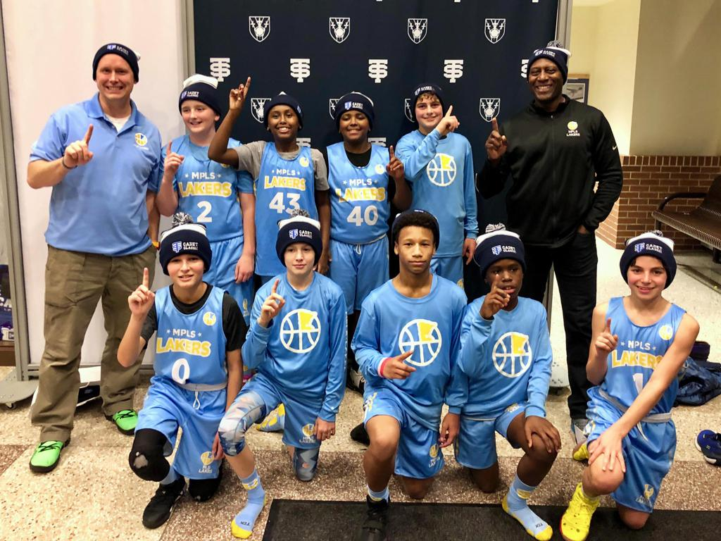 Minneapolis Lakers Boys 7th Grade Blue pose with their Hats after becoming the Champions at the Cadet Classic tournament in Mendota Heights, MN