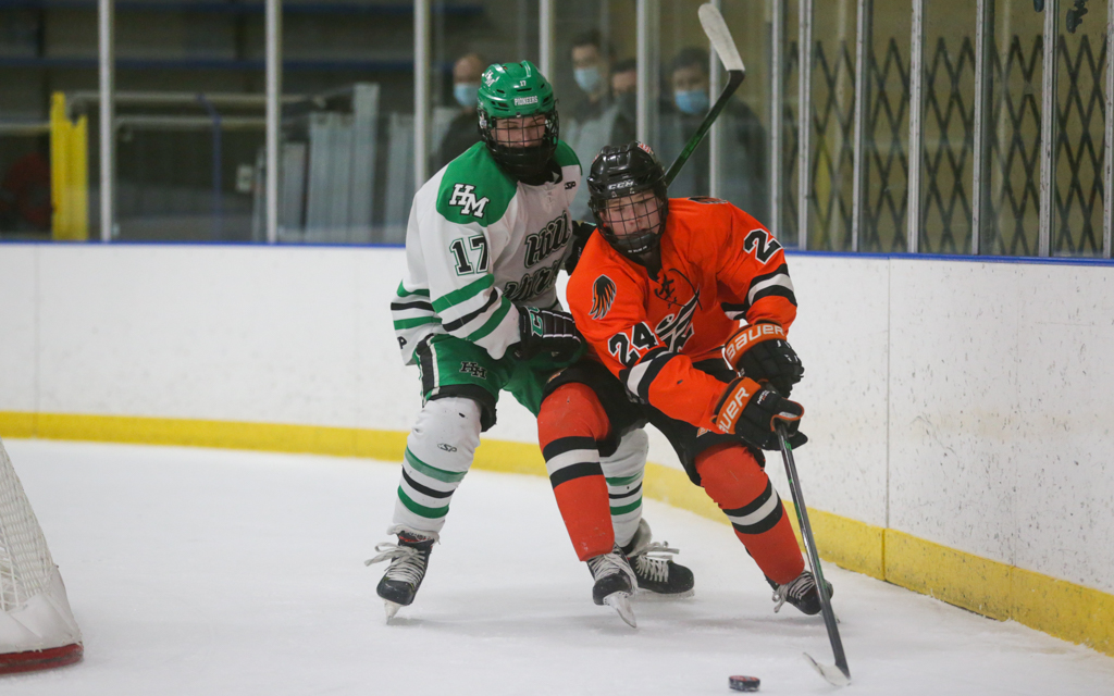 Grand Rapids' Sam Sterle (24) battles Hill-Murray's Dylan Godbout (17) for control of the puck during Saturday afternoon's game. Sterle had a goal in the Thunderhawks' 2-1 victory over the Pioneers. Photo by Jeff Lawler, SportsEngine