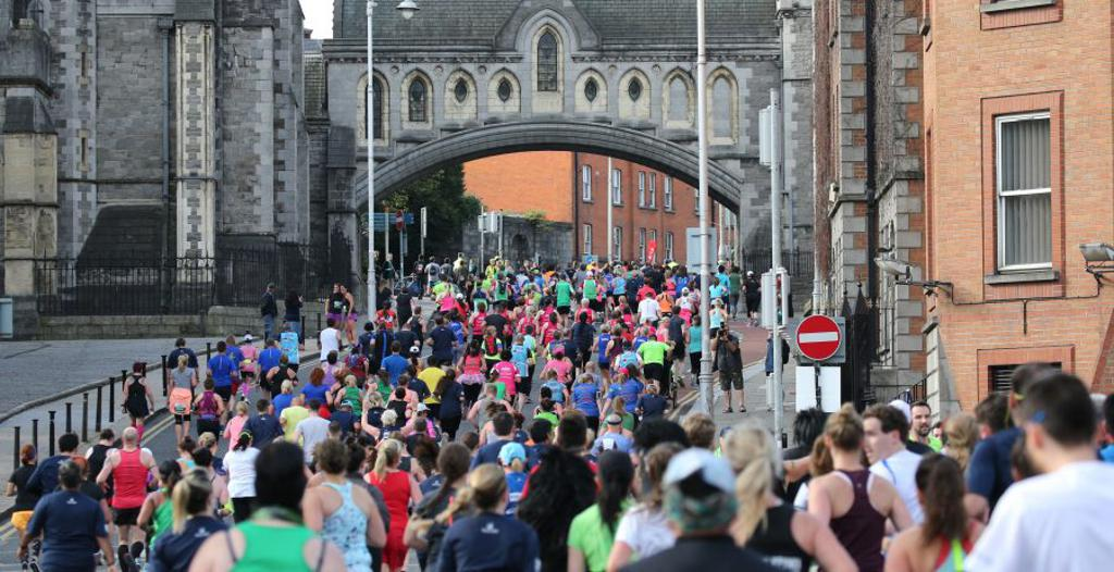 Runners in Dublin under a church like structure