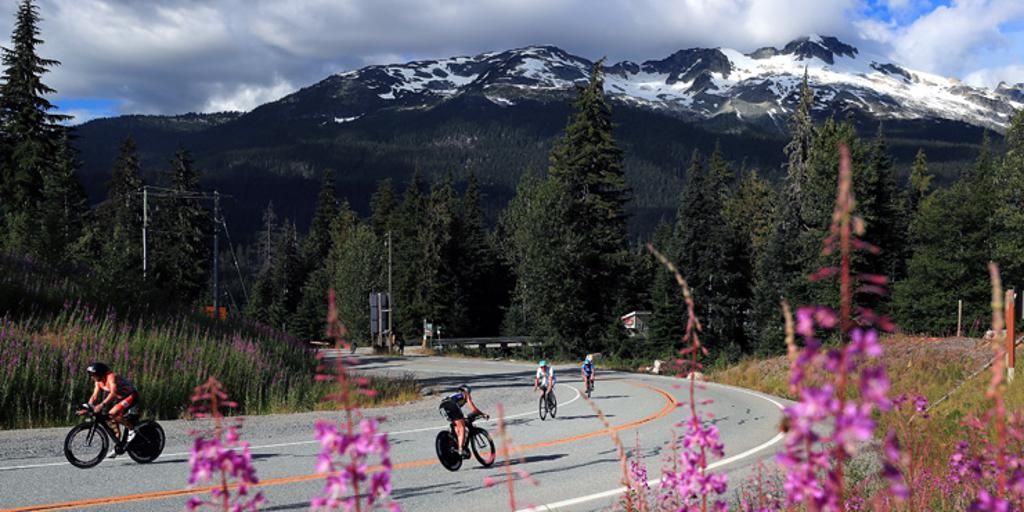Triathletes biking near mountains in Canada