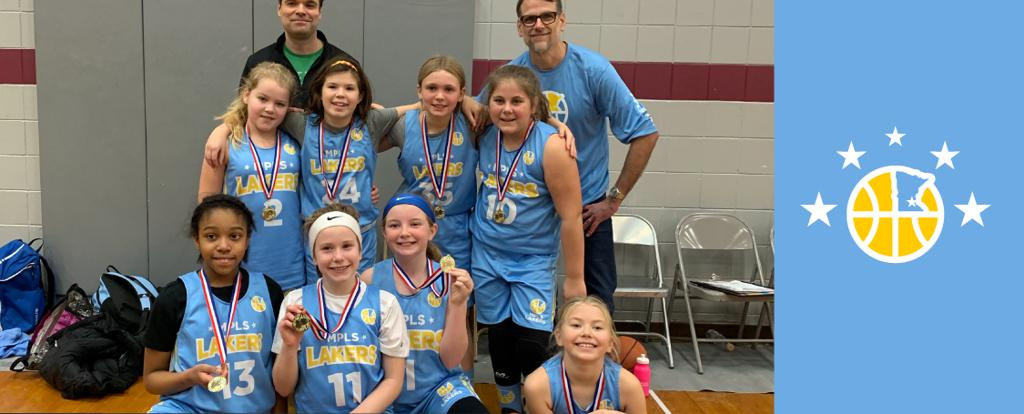 Minneapolis Lakers Girls 5th Grade Gold pose with their medals after earning 2nd place at the Andover Holiday Hoops Tournament in Andover, MN