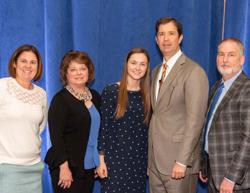 Picture of Anna Settlemyer standing with her parents, principal and scholarship presenters.