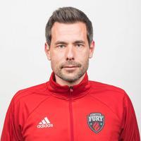 headshot of head coach Nikola Popovic