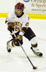 Duluth Denfeld's Matthew Mattila controls the puck during the Hunters' victory over Greenway. Photo by Howie Hanson