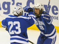 St. Thomas Academy juniors Austin Sattler, right, and Matt Perry celebrate a first-period goal against Hermantown in the state Class 1A championship game. Photo by Helen Nelson