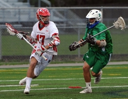 Christian Horn, left, suffered a season-ending injury against Eagan on April 14. Photo by Helen Nelson