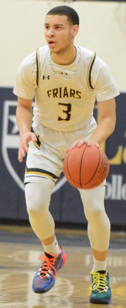 Malik Edwards dribbles a basketball