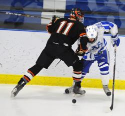 Minnetonka's Jared Ridge, right, goes shoulder-to-shoulder against Moorhead's Austin Skjefte. Photo by Katherine Matthews