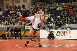 Freeport's Lee Mauras wrestling State Champion Justin Vines of Wantagh
