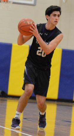 Mike Memmo dribbles a basketball