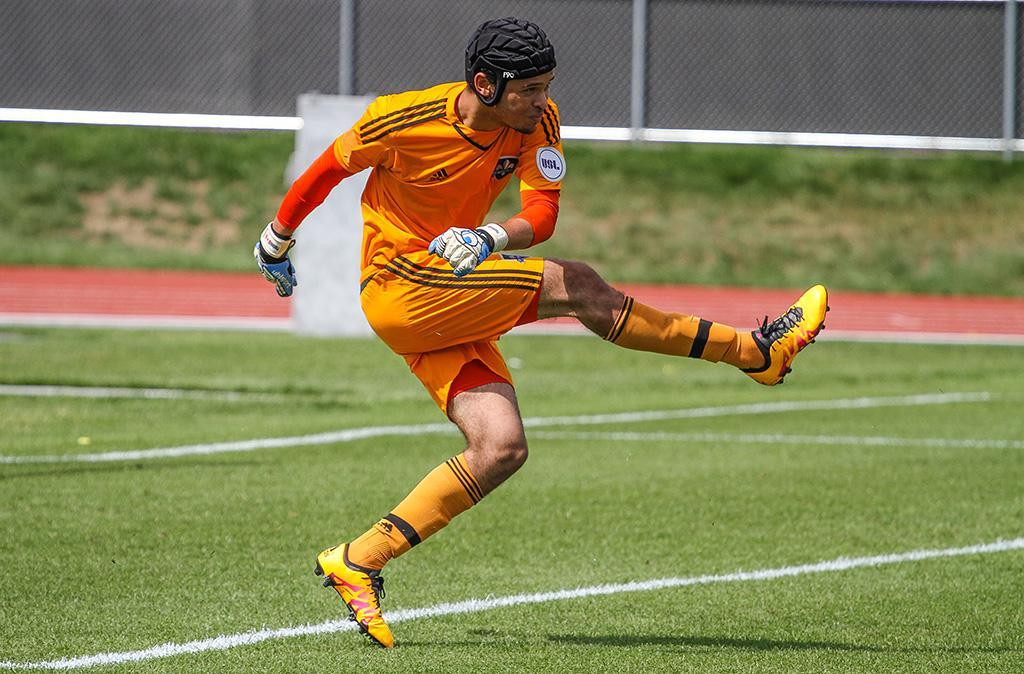 David Paulmin follow through his kicking motion after restarting the play with a goal kick