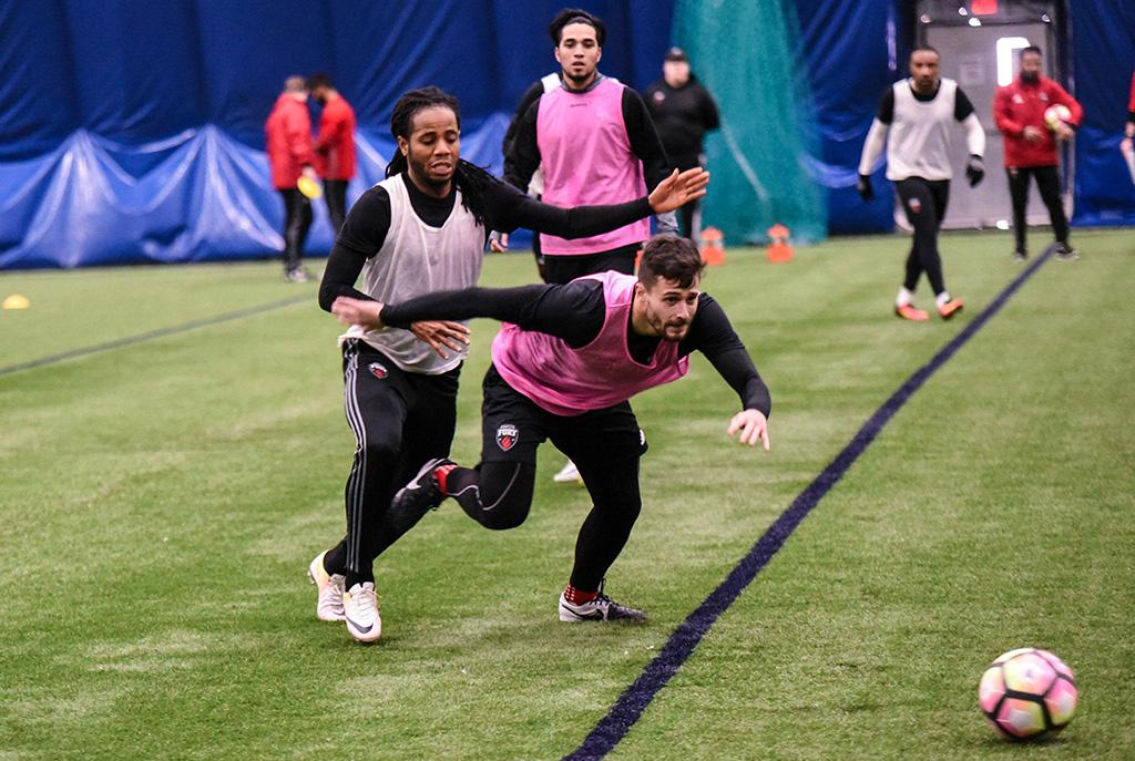 Andrae Campbell (behind) and Sito Seoane (in front) battling for ball possession at training