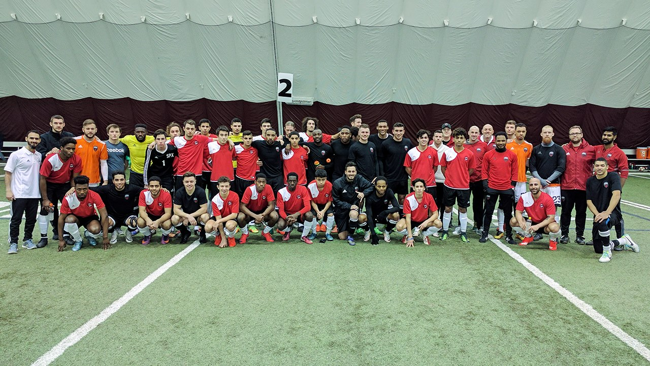Fury FC and Ottawa Internationals players and coaches posing for a photo after their preseason match