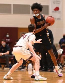 Marcus Randolph holds a basketball
