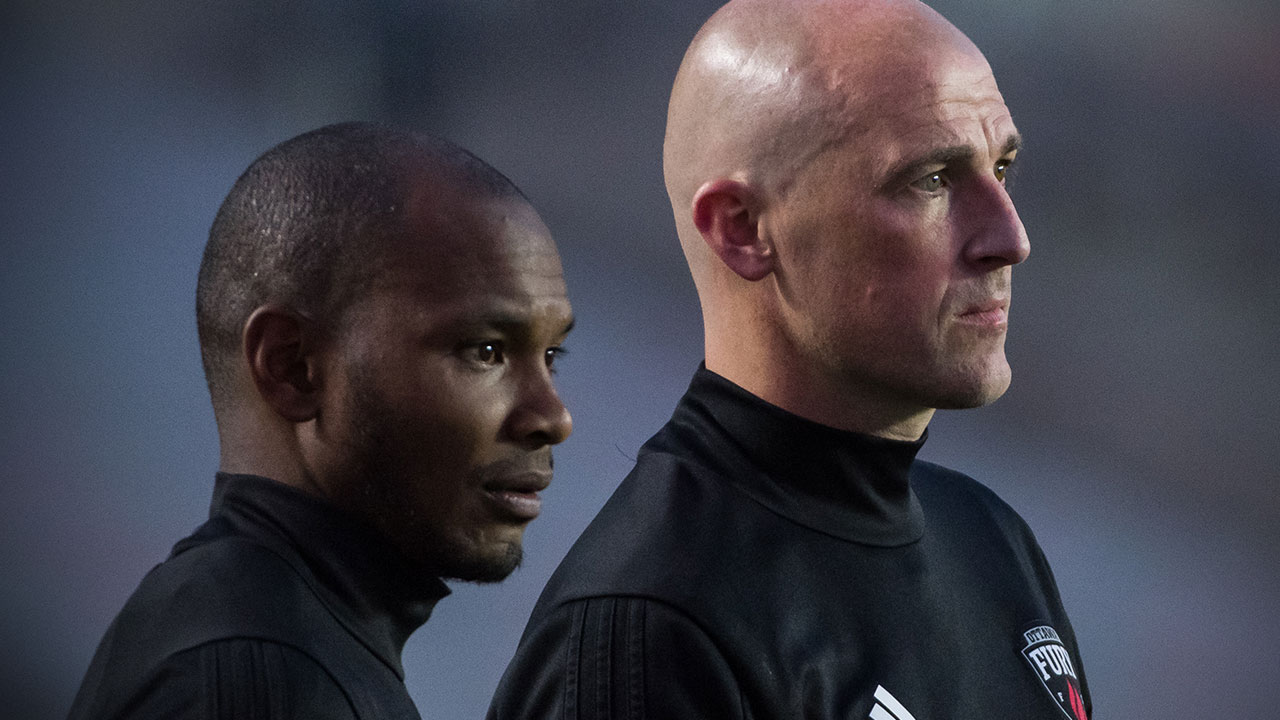 Julian de Guzman, on the left, and Paul Dalglish, on the right, standing side by side in their black Fury top