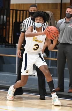A boy holds a basketball