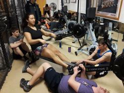 Lake Braddock rowers on the erg