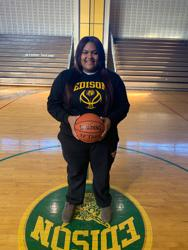 Dussinger holding a basketball