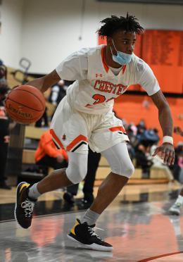 Karell Watkins drives to the basket