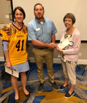 PAL Football Commissioner and PAL Board of Directors member Sharon Wiegand accept Parole Rotary donation